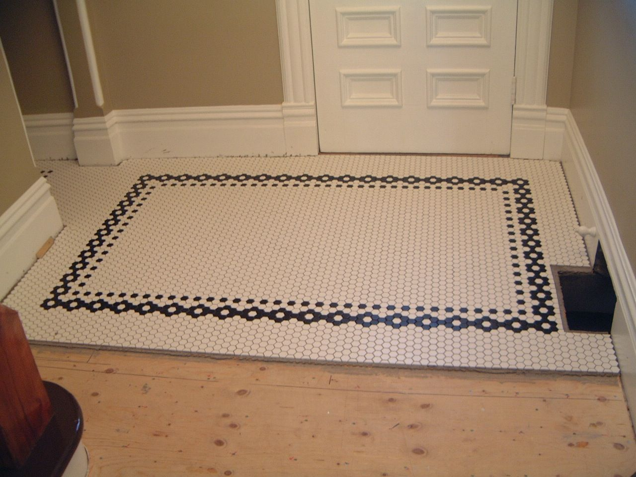 Creative tile flooring patterns small white hex tile with black design ideas inspiring bathroom flooring design ideas using white hexagon floor tile pattern and white wood bathroom door cool flooring design ideas using dailygadgetfo Images