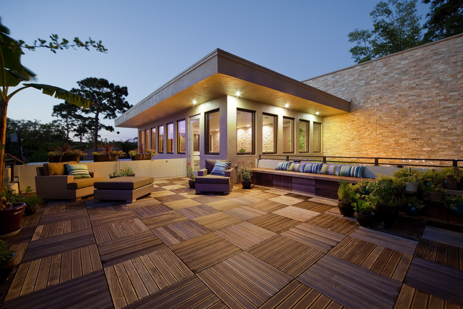 Superb #rooftop Design With Wood Tiles And Futon Furniture Set Also  Greenery In Pots |