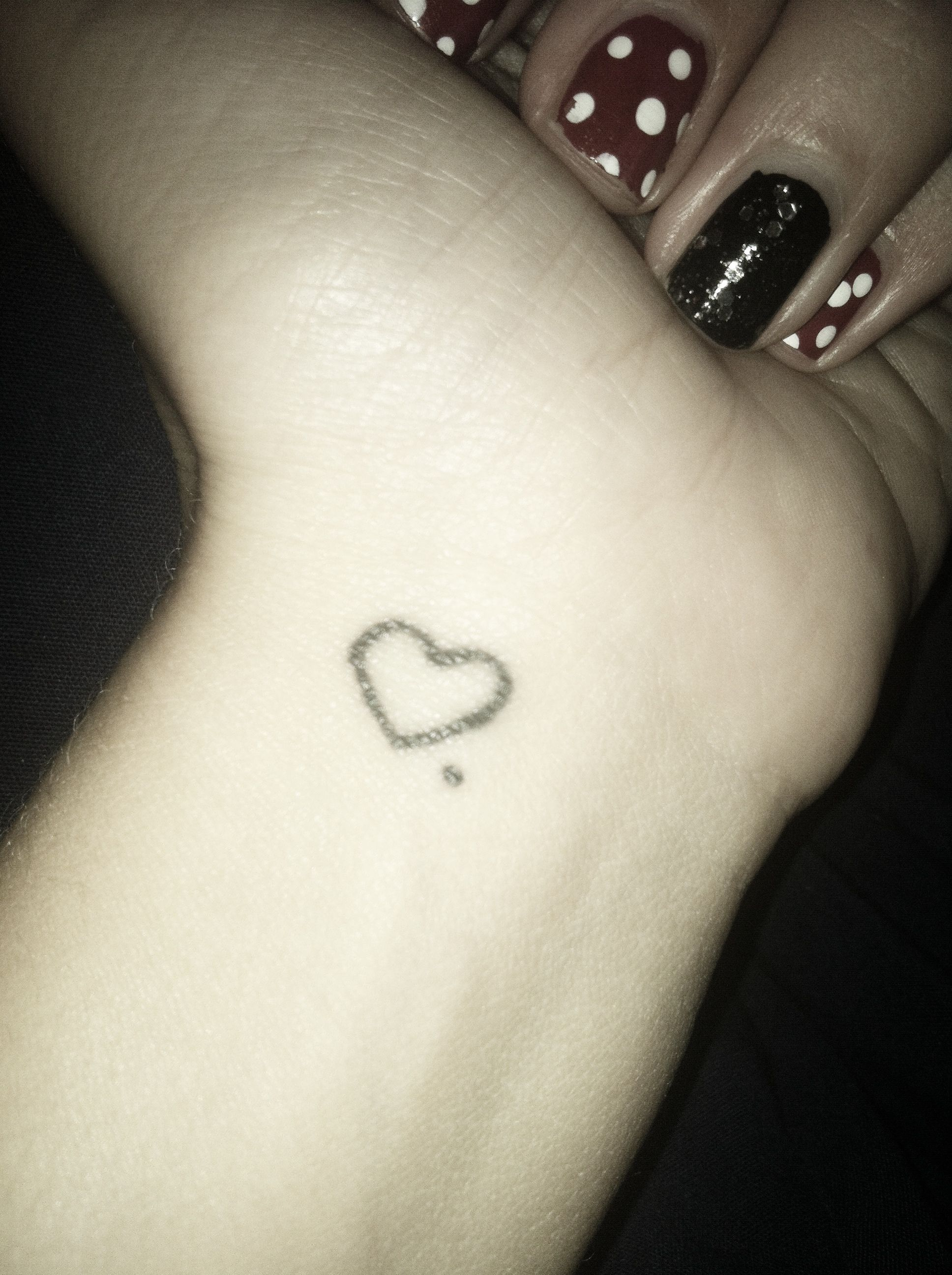 Wrist heart tattoo