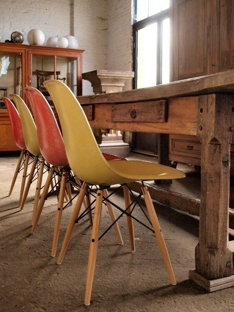 Vintage Eames Side Shells On Maple Dowel Bases Against An Amazing Wood Farm Table