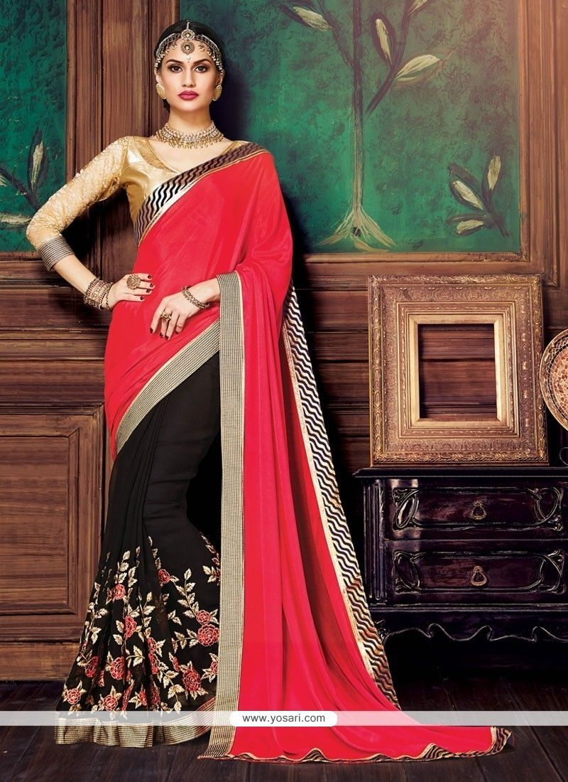 Half saree blouse design conspicuous patch border work black and pink satin designer half n