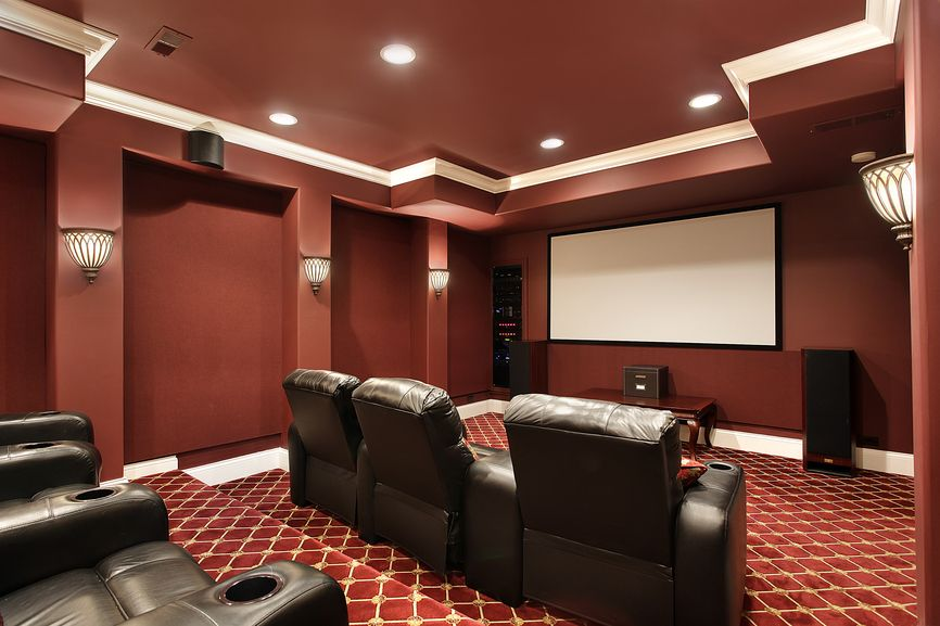 Ruby Red Designed Home Theater With Stadium Seating And Brown Leather Plush Seats