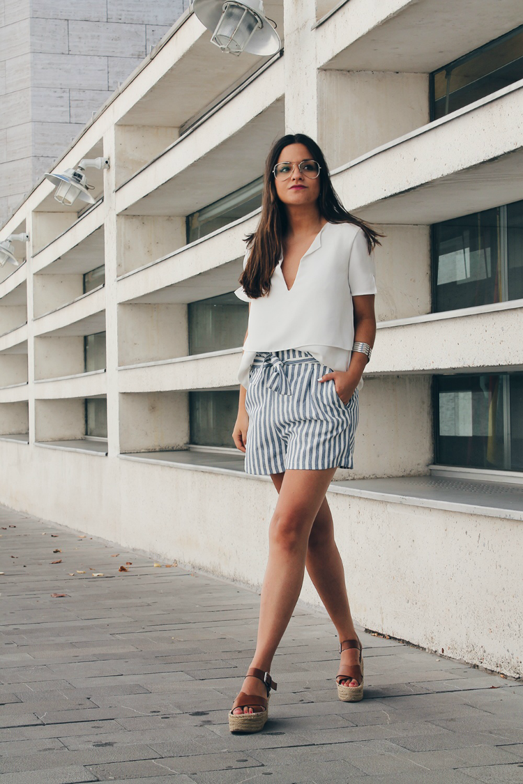 Work summer #outfit wearing striped shorts and white top