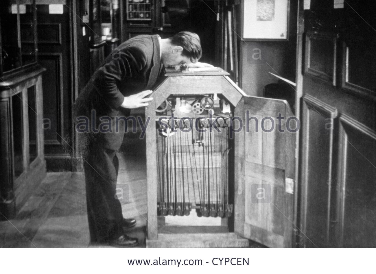 Man Looking into a Kinetoscope, Invented by Thomas A. Edison in 1889 ... for Kinetoscope Thomas Edison  111bof