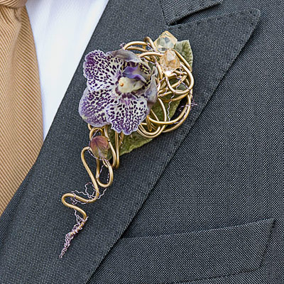 Contemporary style orchid boutonniere by Philippe Bas. philippebas.be