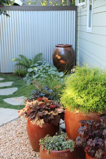 Placing A Planted Container Near The Front Door Is An Excellent Way To Create An Inviting Entry E Container Gardening Landscaping Inspiration Garden Containers