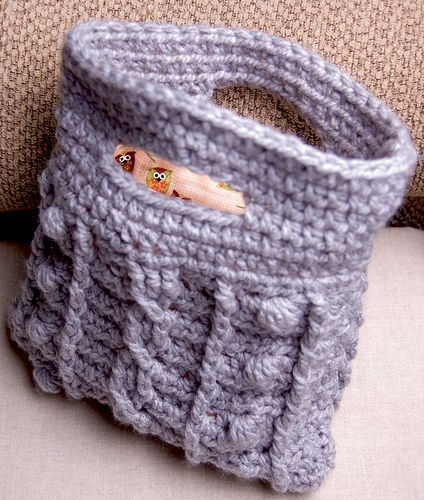 Cabled Bobble Clutch.  Crochet pattern.  Also has a knit pattern now for $3.50.  Relatively simple, and super cute.  Pattern in binder.