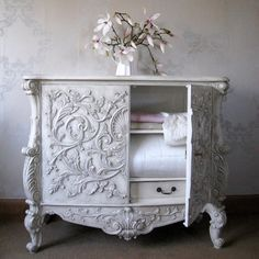 lovely white chest with intricate molding...