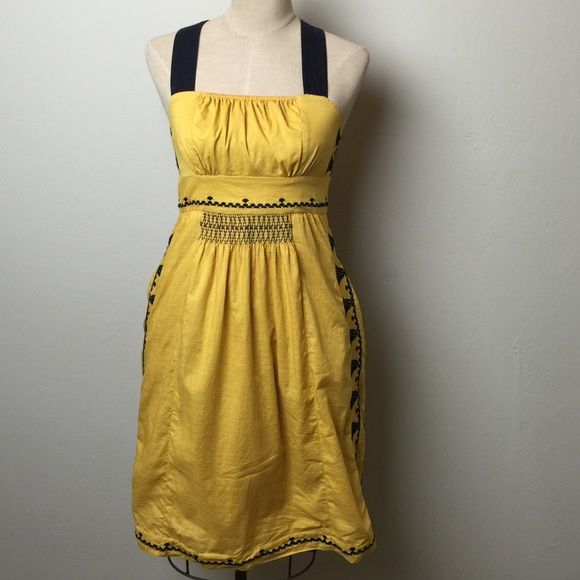 Anthropologie embroidered Floreat dress Gorgeous embroidery and elasticized smocking detail. Side zip. Fully lined. Lining has lace at bottom edge. 2 side pockets 100% cotton size tag is missing, but I believe this to be a small Anthropologie Dresses