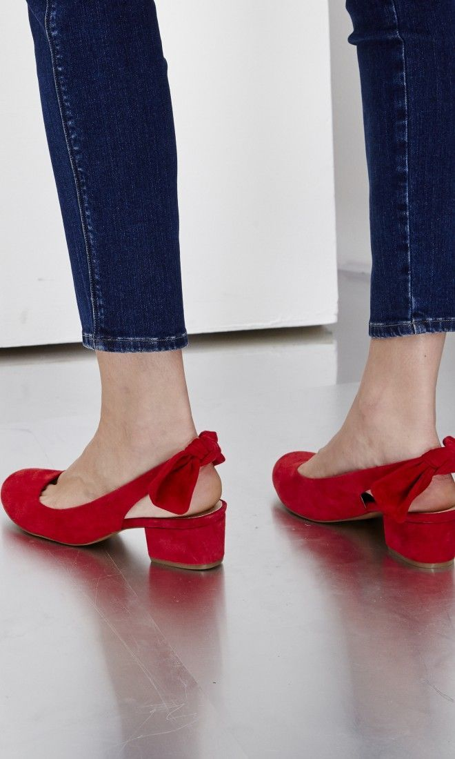 red flats with bows.Gorgeous shoes for women. Retro inspired red shoes.