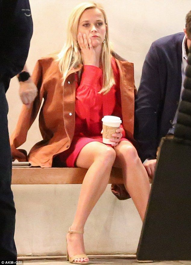 Working girl! Reese Witherspoon, 40, puts on a leggy display in chic red dress as she puts...