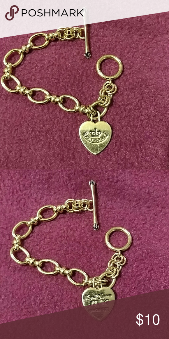 """Juice Couture Gold Tone Bracelet 7 1/2"""" long. Good condition. Some light scratches on the heart Juicy Couture Jewelry Bracelets"""