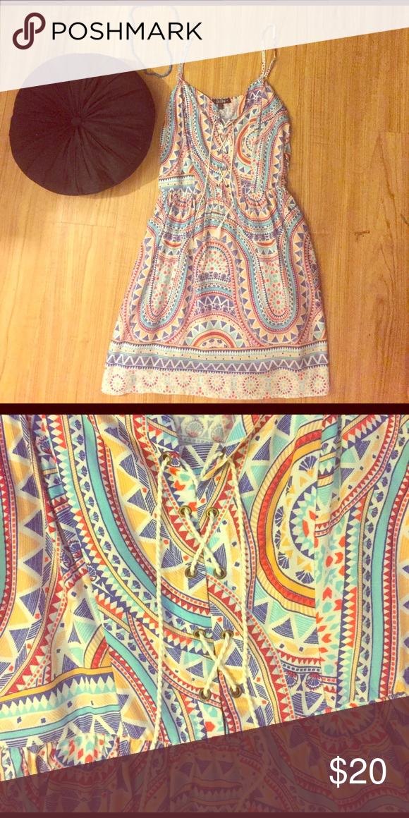 """Adorable patterned sundress with tie up neckline Adorable patterned sundress with tie up neckline- knee length on me I'm 5'6"""" adjustable straps. Breathable material. Would fit a d-cup bust Dresses Midi"""