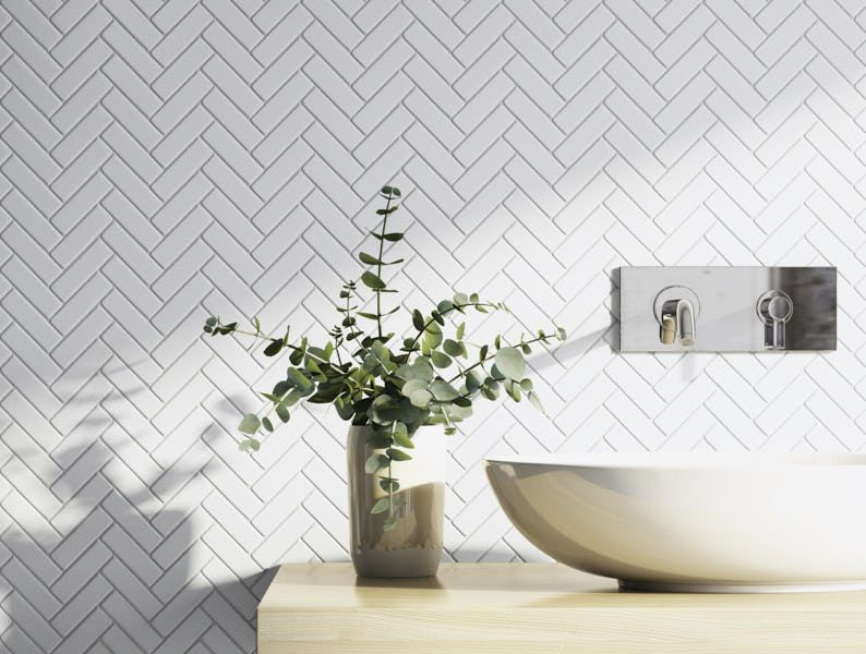 white herringbone tile backsplash