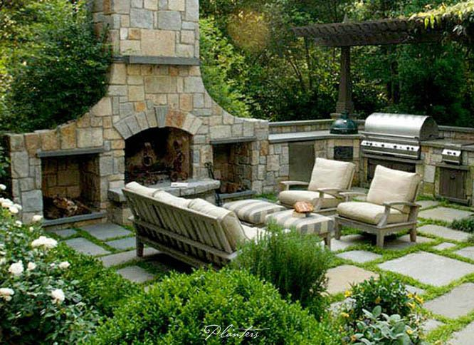 Teak Patio Furniture In Front Of An Outdoor Fireplace. A Planters Design.  Atlanta,