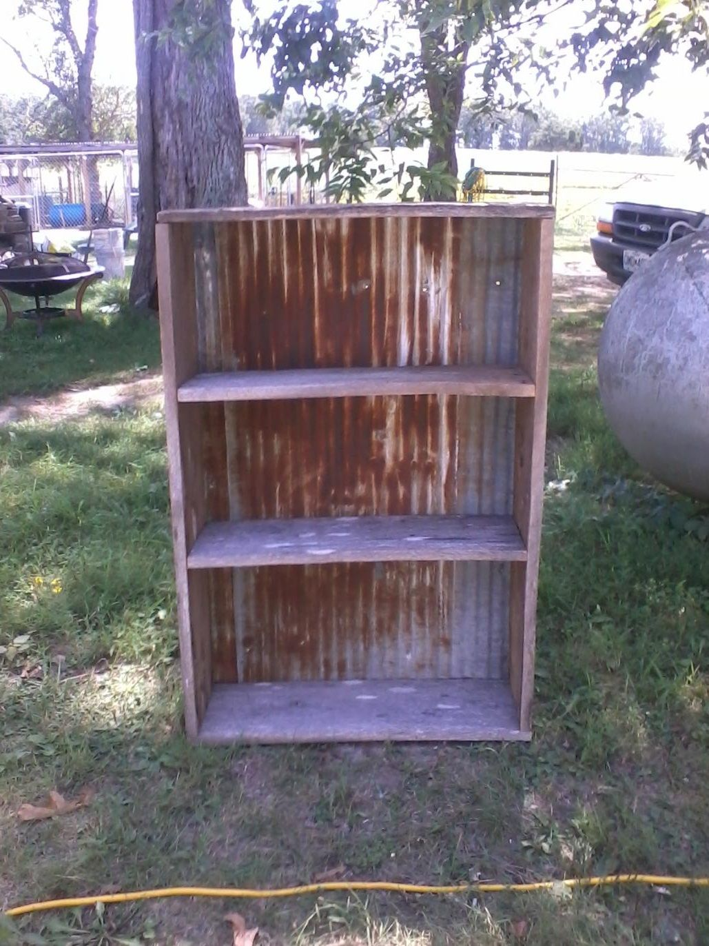 My husband made this out of old barn wood and tin love it for Old barn tin ideas