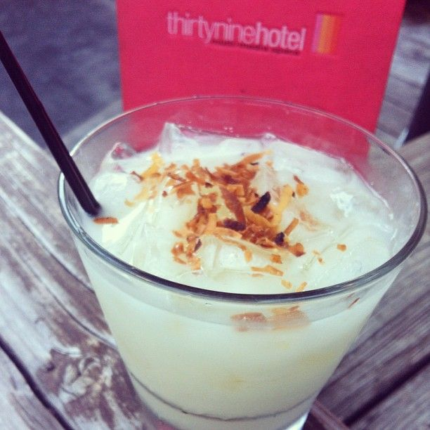 Deliciousness in your mouth! Koko Head Colada! One of #COTD. Mango rum, coconut milk, pineapple and toasted coconut flakes.