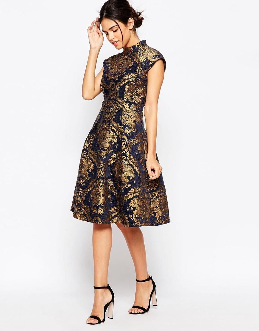9a0e23c97cb8 10 Gold Dresses to Wear on New Years Eve - Chi Chi London High Neck  Structured Skater Dress In Baroque Print