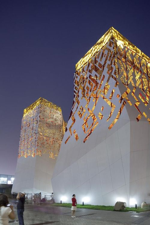 Russian pavilion by TOTEMENT | PAPER Bureau 12 irregularly shaped towers in white, red and gold and a 15m tall central building dubbed the 'civilization cube' which links them.
