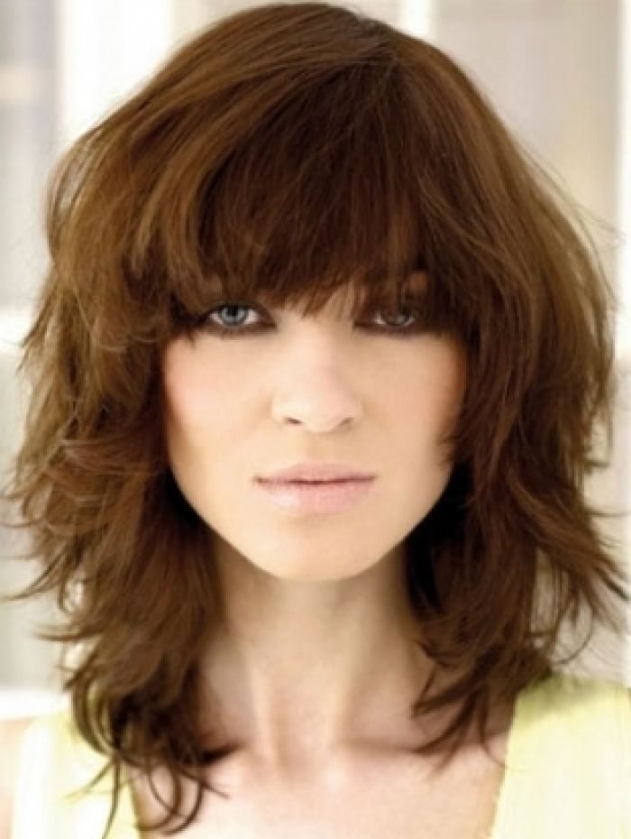 medium hair cuts with bangs