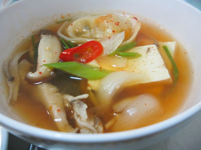 Mandu Dubu Jeon-gol -- Jeon-gol is a spicy hot Korean soup dish that is made in a big shallow pot. The ingredients are usually arranged neatly in the pot, along with the soup stock and spicy sauce, and then everything gets cooked right at the dining table on a portable gas stove. As the soup continues to boil, the flavor becomes more intense.