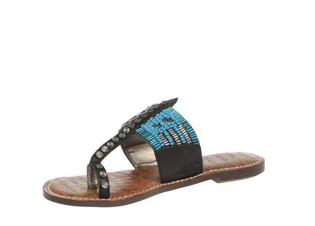 A slim toe ring and tribal-inspired design lend some boho-chic vibe to this embellished thong sandal.