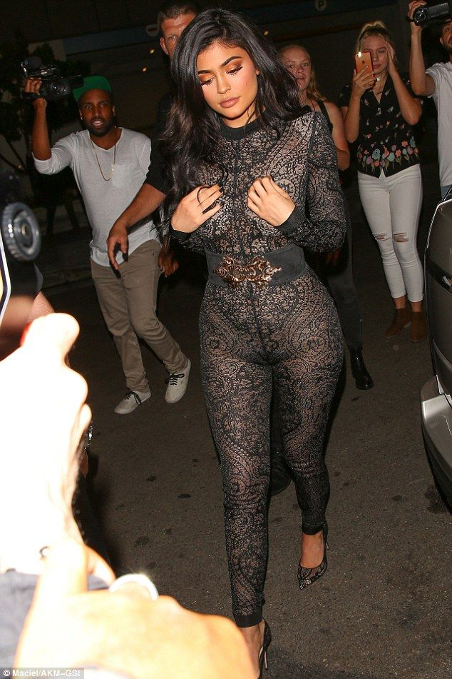 082054e9cff Jumped the gun  Kylie Jenner wore a see-through lace jumpsuit as she  celebrated her 19th birthday early in West Hollywood