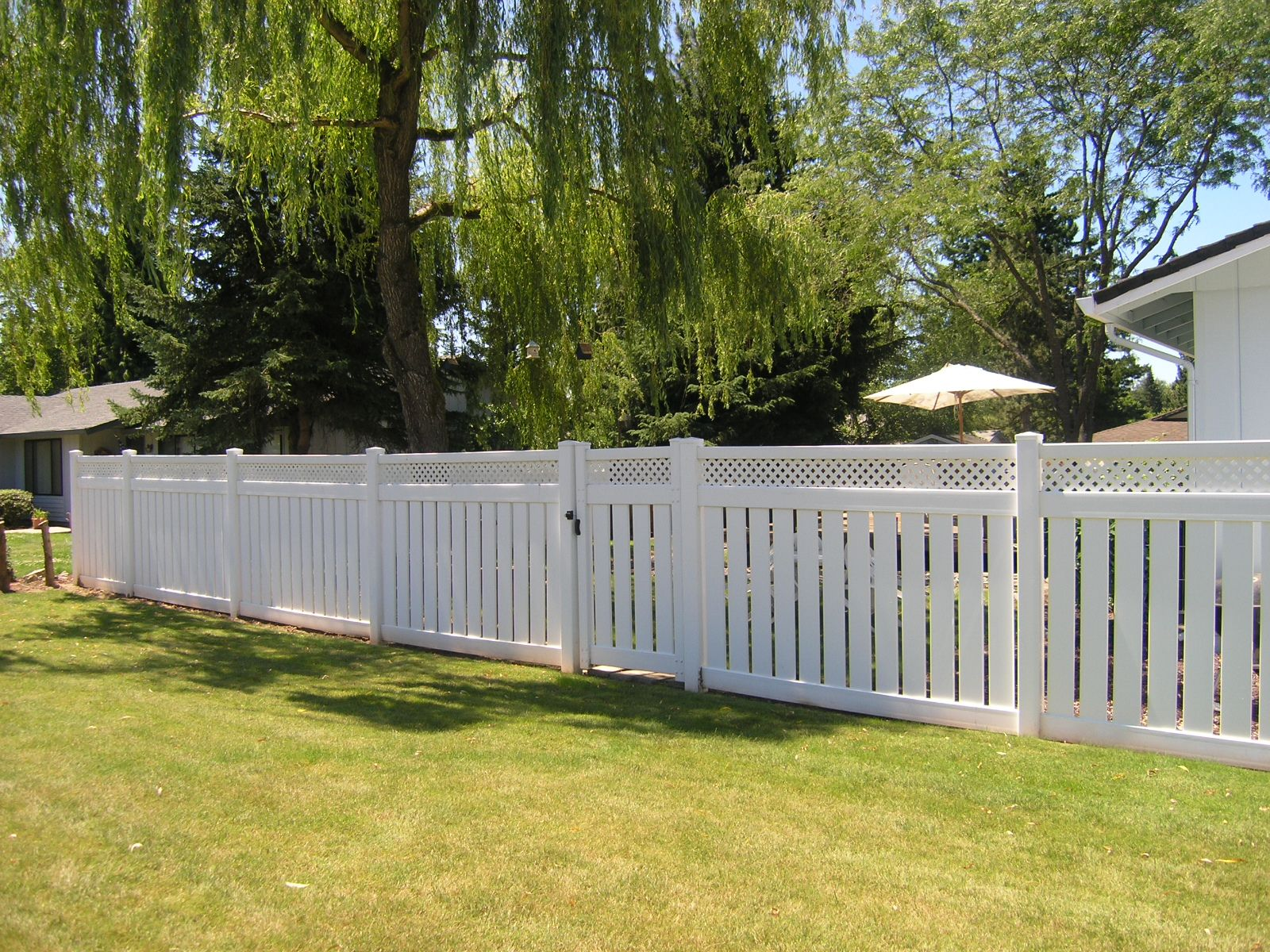 Semi Private Vinyl Fencing Is Durable Beautiful And Great For Adding A Bit Of Privacy Without Blocking Everything Out Outdoor Patio Diy Patio Table Patio