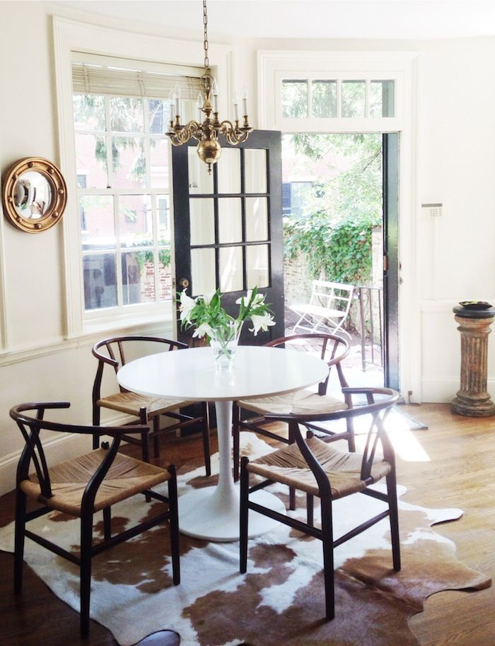 Christine Alice Interiors Dining Area: Ikea Docksta Table, Wishbone Chairs, Convex Mirror and Cowhide Rug
