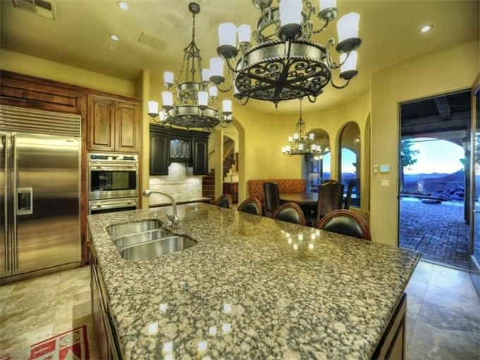 Magnificxint kitchen in this home located on the side of a mountian with panaramic view in Cave Creek, AZ via:sothebysrealty.com