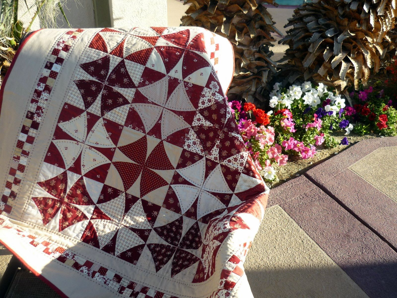 Winding way quilt in red and white.