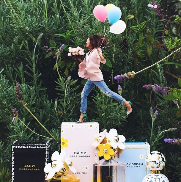 Celebrating Daisy Day with a happy jump across my favorite @marcjacobsintl perfumes! #MJDaisyChain ❤️