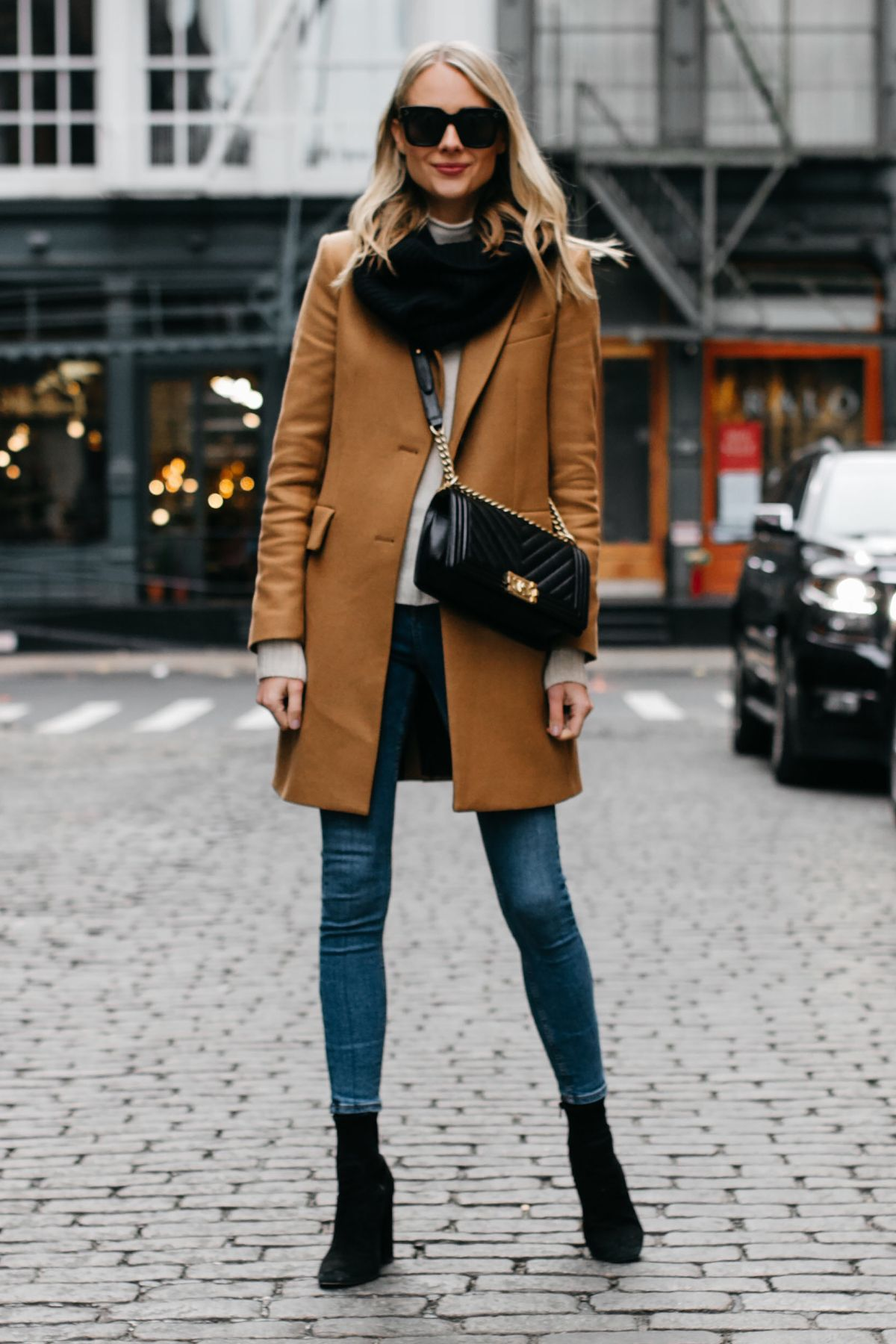 bb6847017c5 Blonde Woman Wearing Camel Coat Black Scarf Denim Skinny Jeans Black  Booties Chanel Black Boy Bag Fashion Jackson Dallas Blogger Fashion Blogger  NYC Street ...