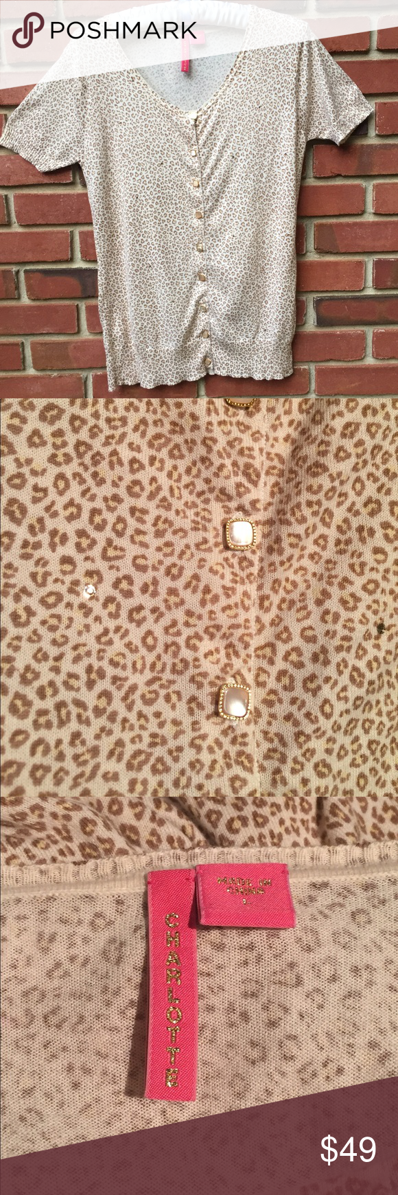 """Charlotte short sleeved sweater This darling Charlotte 100% cotton sweater is lightweight enough to wear throughout a hot summer! 🌞 The darling buttons and light """"jewels"""" dot the sweater to give a subtle sparkle--see photo. Charlotte Sweaters"""