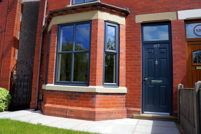 Anthracite Grey windows and composite door updating a period property in Wigan. Call us on & Anthracite Grey windows and composite door updating a period ...