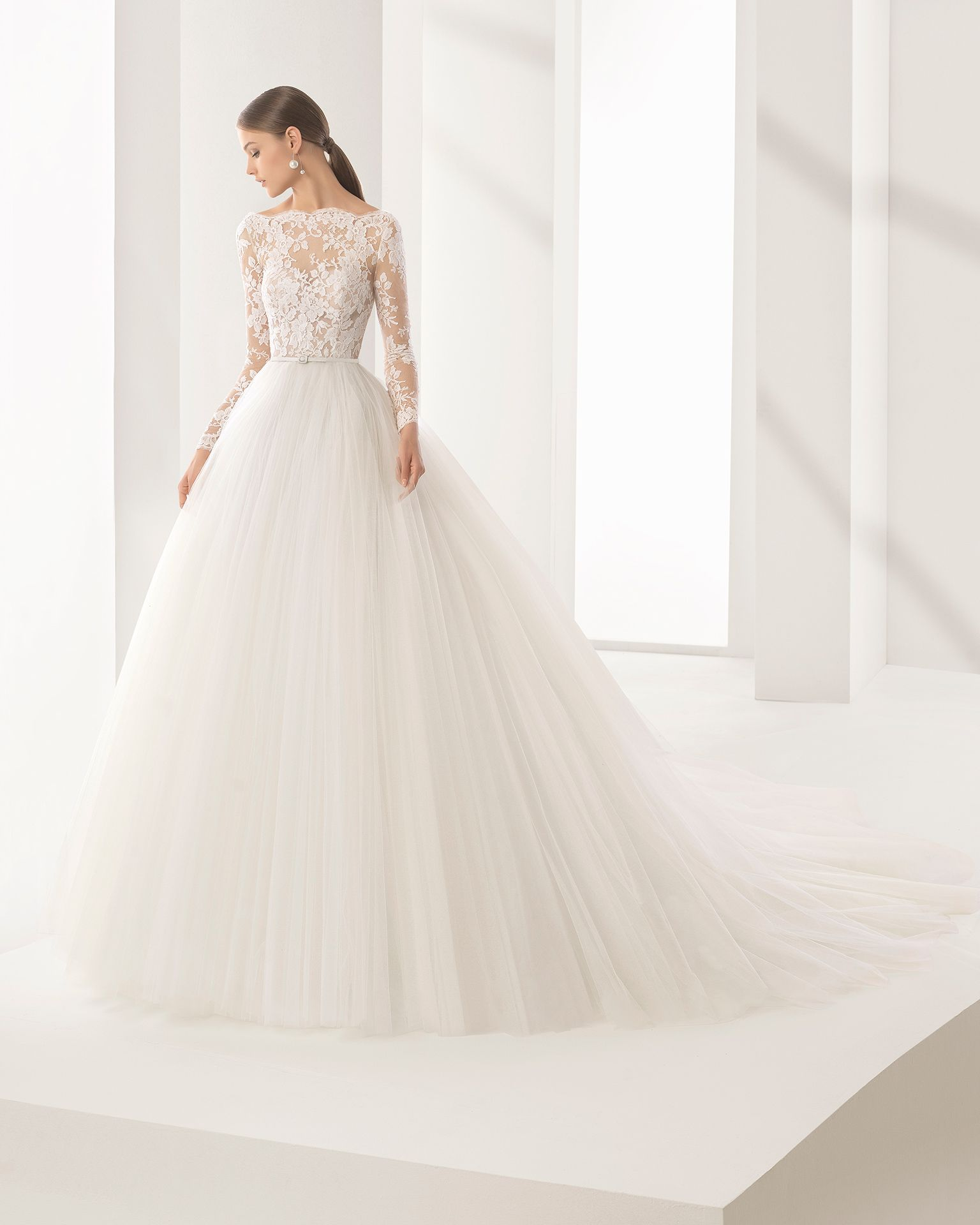 62713845 Princess-style wedding dress with long sleeves, bateau neckline, lace  bodice with sheer inserts and tulle skirt. 2018 Rosa Clará Couture  Collection.