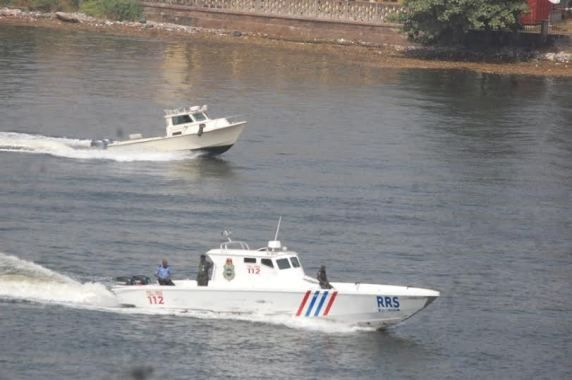 newly acquired Lagos state RRS Surveillance Helicopter Gunboat on Patrol : see amazing shot from far