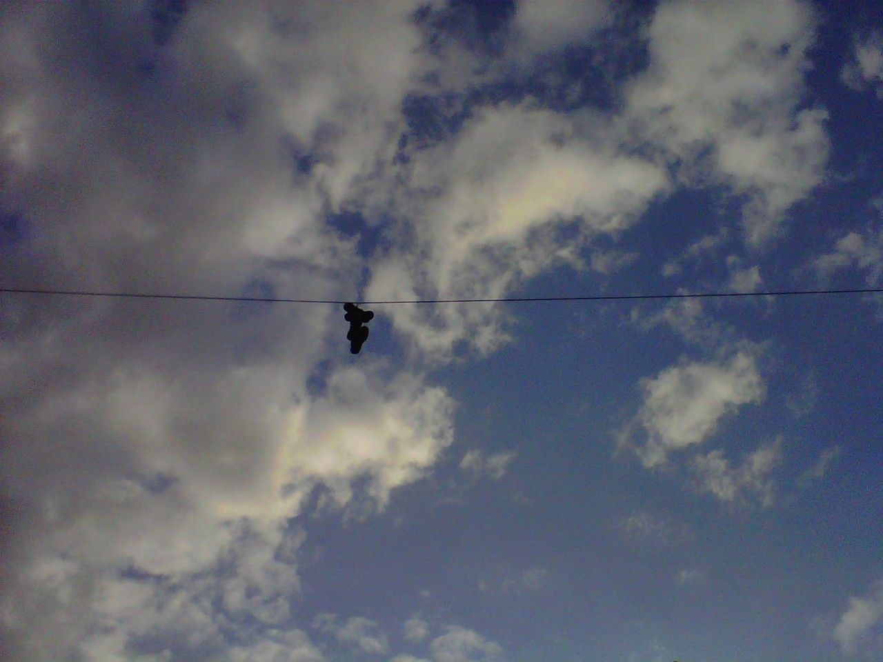 Colgar los tennis (to hang your shoes at public wire) is a way of ...