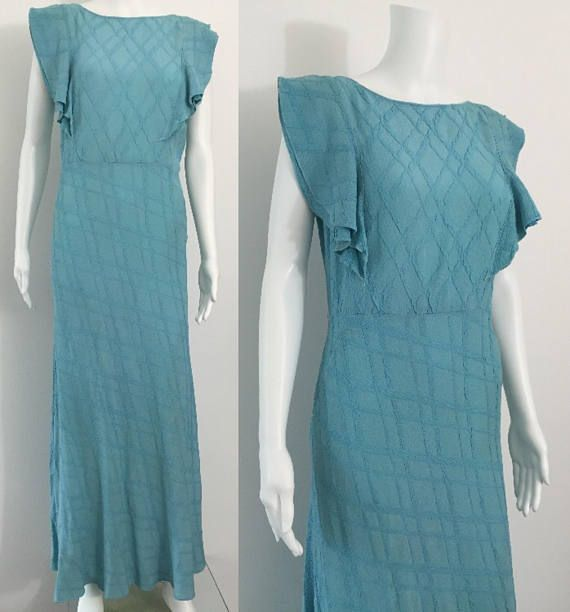 This is a beautiful original 1930s gown. Its a lovely Aqua ...
