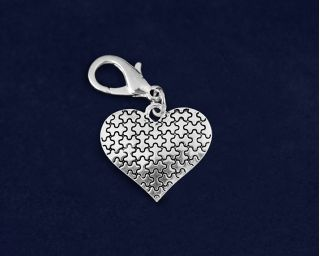 Silver Puzzle Piece Heart Hanging Charms. These autism silver puzzle piece heart hanging charms are approximately 1 inch x 1 inch with a clasp. Packaged 25 hanging charms per pack. Product Code: HCHARM-94-2