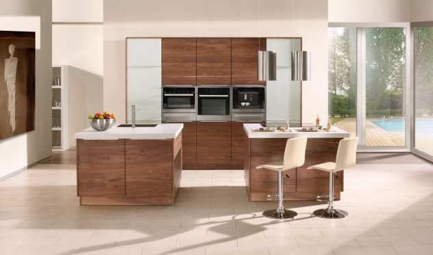Küche mit Design-Exklusiv aus der Oster Möbelkollektion Küchen - arbeitsplatte küche nussbaum