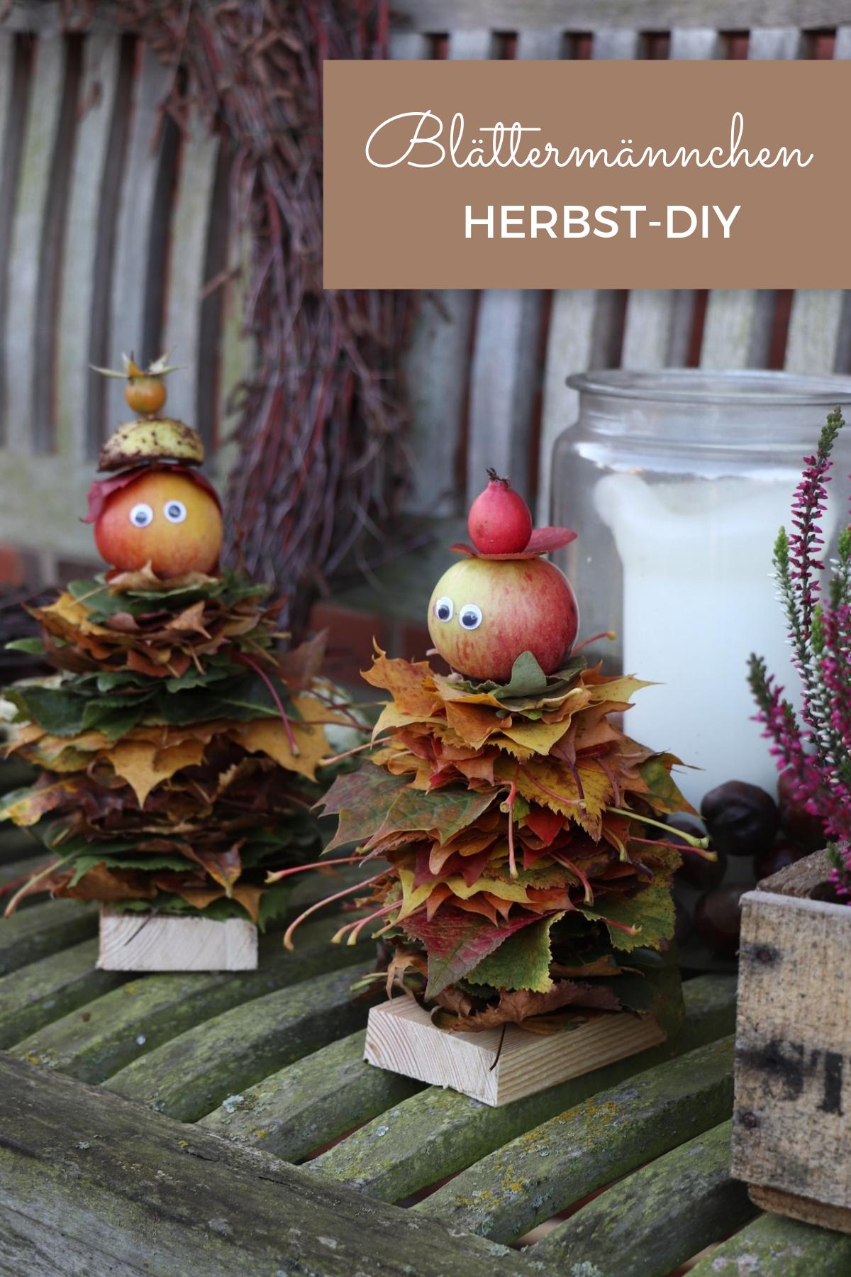 Herbst-DIY: Blättermännchen basteln kann man aus Naturmaterialien. Die Apfel Männchen können individuell gestaltet werden und sind eine schöne Herbst Gartendeko. Das Blätter DIY kann man gut mit Kindern im Herbst basteln.