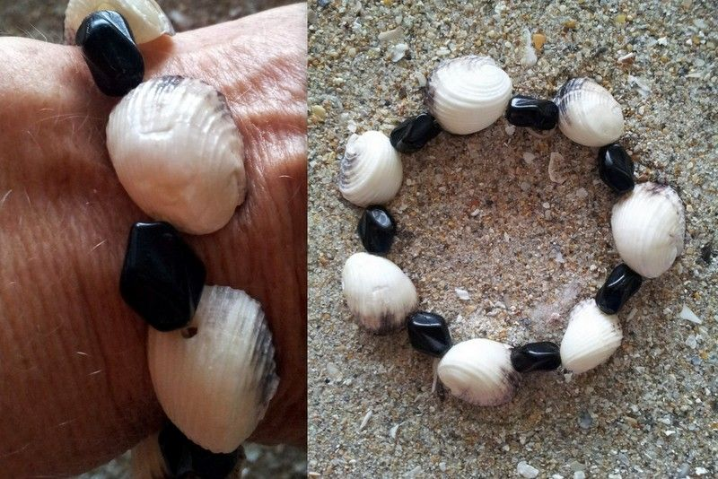 """Bleeding tooth and black faceted beads on stretch cord. measures 7"""" 1/2 relaxed. $15"""