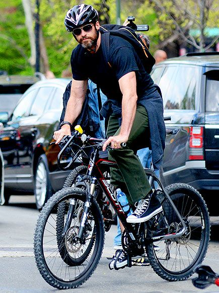 ROLL OUT | Looks like he's having a wheely good time! Hugh Jackman puts the pedal to the metal during a bike ride through New York City on Friday.