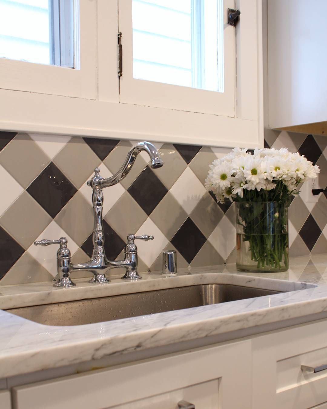 You cannot go wrong with a check tile back splash and carrara marble ...