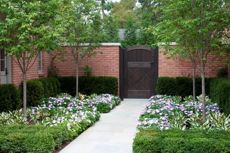 Wooden Privacy Gate Brick Wall Gates And Fencing Zaremba And Company Landscape Clarkston Mi Brick Fence Landscape Design Fence Landscaping