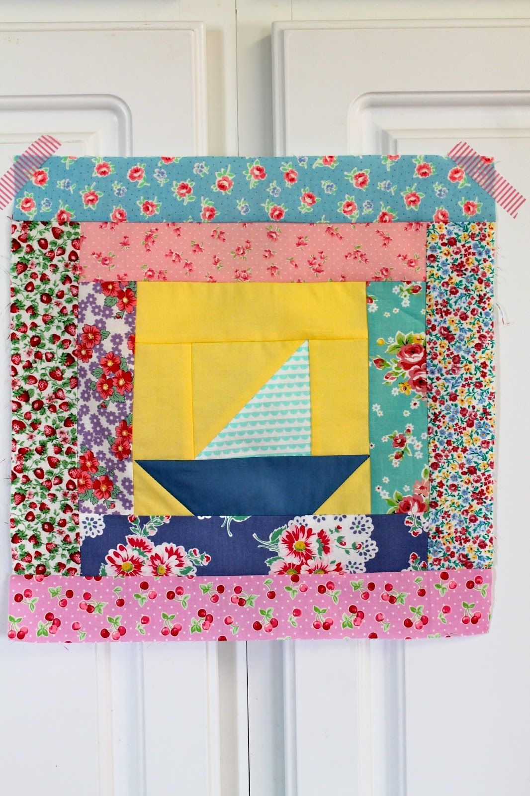 cute sailboat log cabin block @ sewn with grace: free pattern here