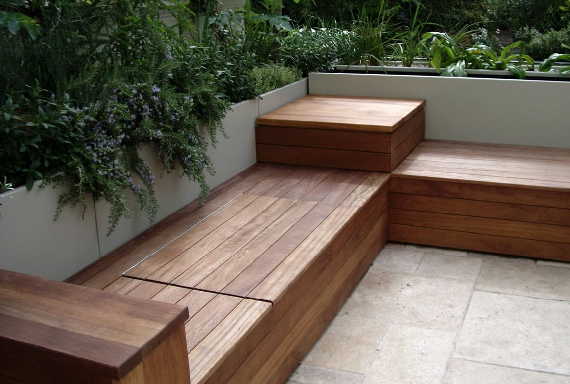 Built in storage for a wooden bench seating garden bench