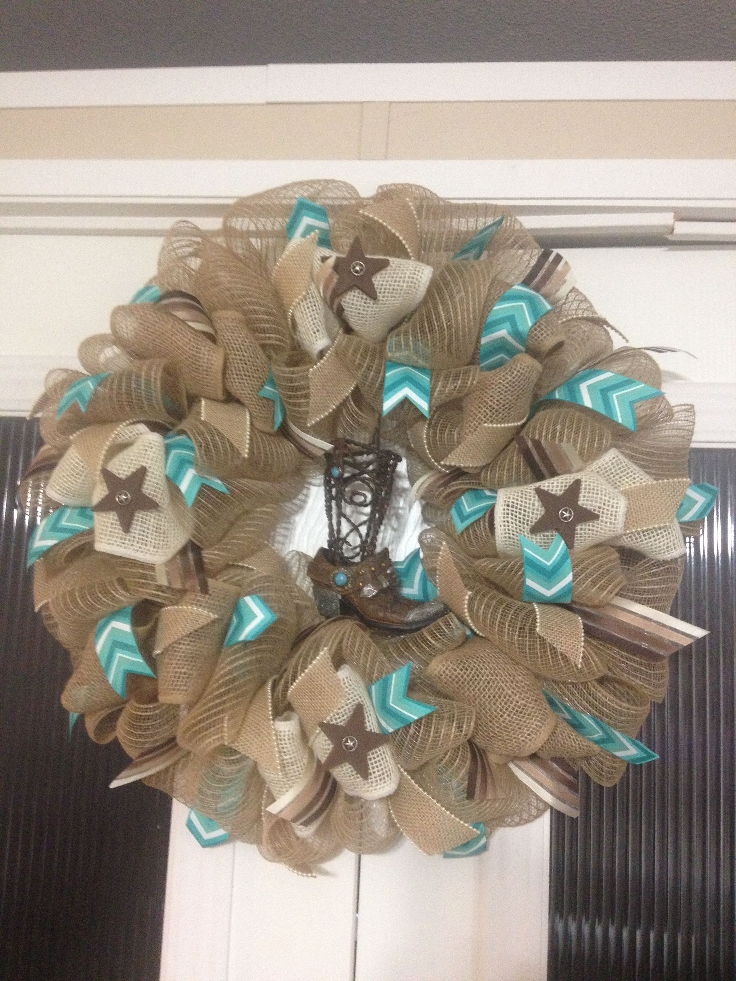 Western wreath with boot and turqoise color and stars created and designed by Ronda Cromeens. Large 50$. Made with burlap