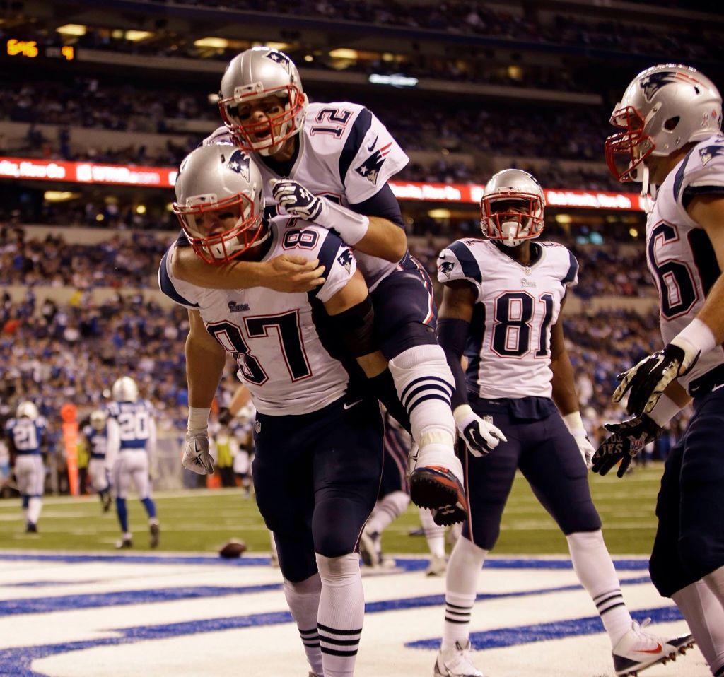 Rob Gronkowski 87 Giving Tom Brady 12 A Piggy Back Ride New England Patriots Gronkowski New England Patriots Football